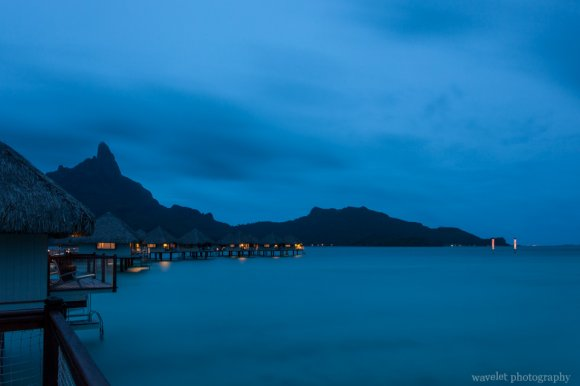 Night view of overwater bungalows of Le Méridien Bora Bora again Mount Otemanu