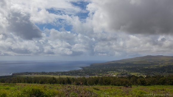 Overlook the town and the island's west coast from Rano Kau, Easter Island