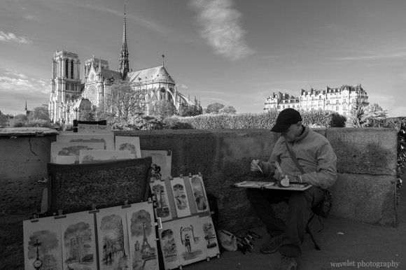 A painter near Pont de l'Archevêché, Paris