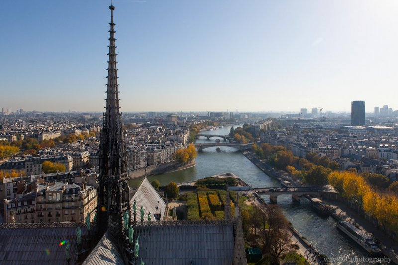 Overlook River Seine to the east with the spire of Notre-Dame de Paris in the foreground