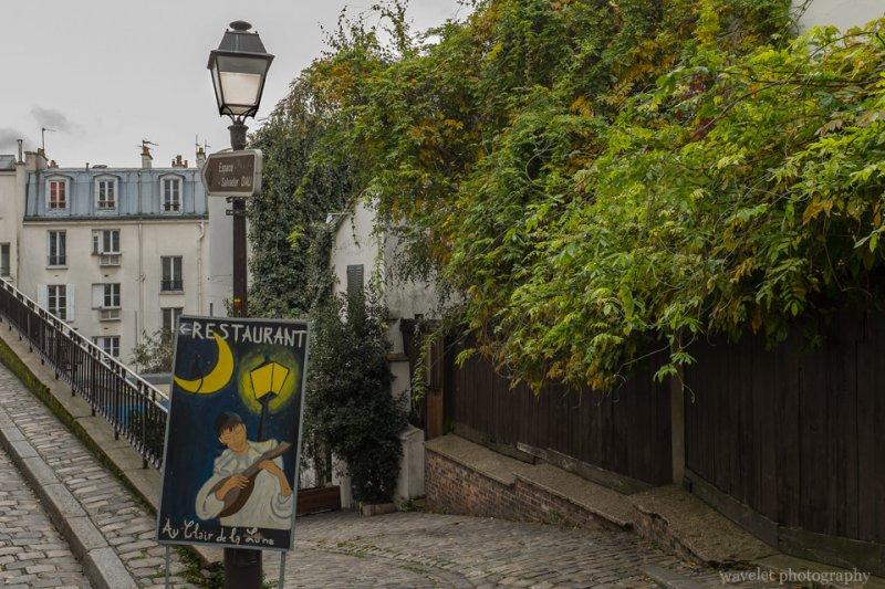 A restaurant sign on Rue Poulbot, Montmartre, Paris