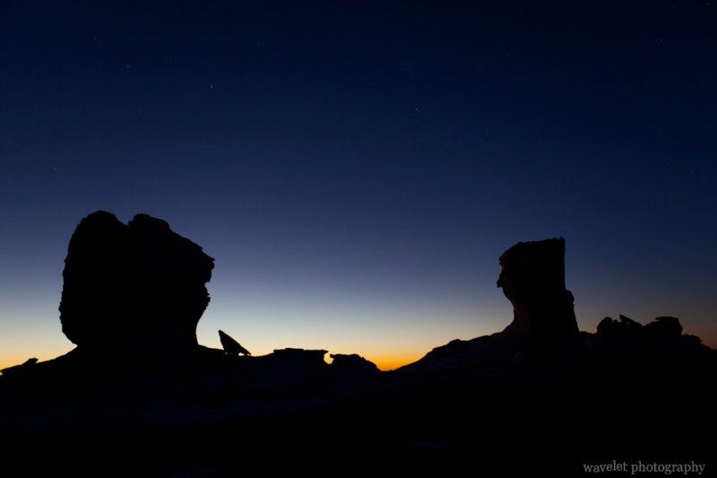 Silhouette of Rocks in White Desert Half an Hour before Sunrise