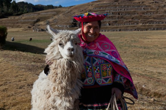 Woman in traditional clothing with her Alpaca, Sacsayhuamán