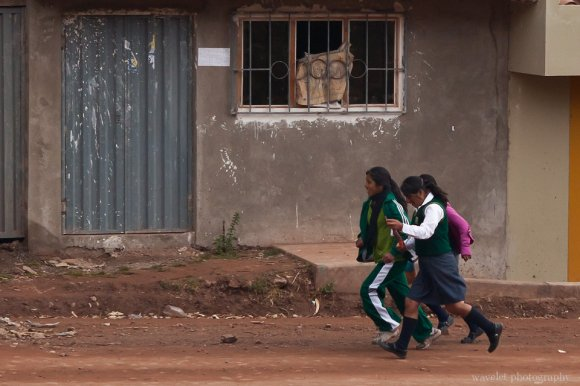 Students running to school, Sacred Valley
