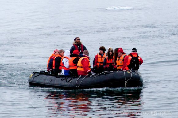 Visitors Wearing Parka and Life Vest on a Zodiac