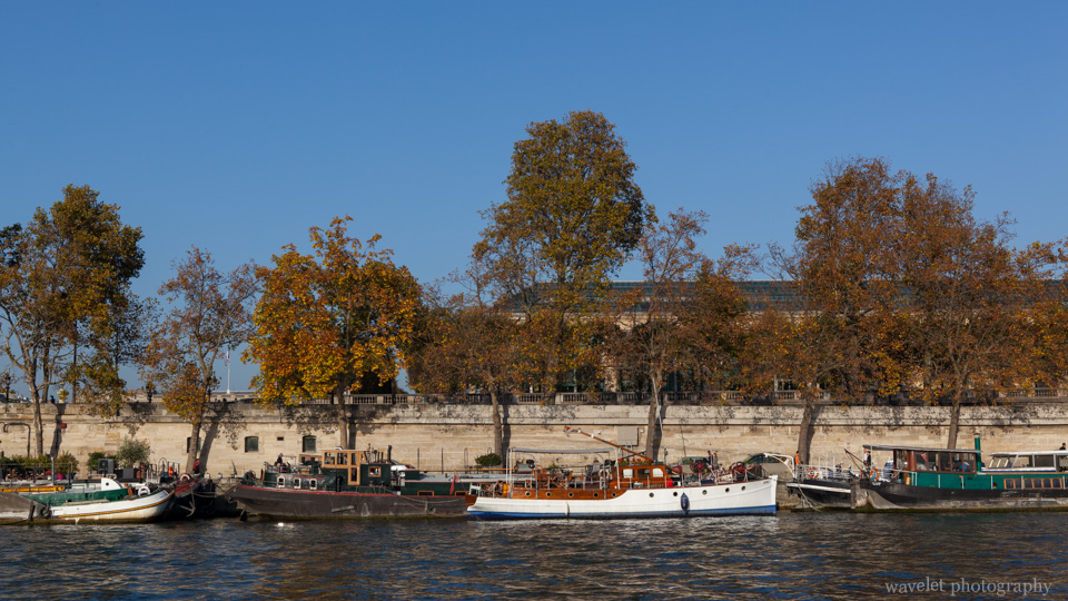 Tourist boats on the Seine River against Musée de l\'Orangerie on the Right Bank, Paris