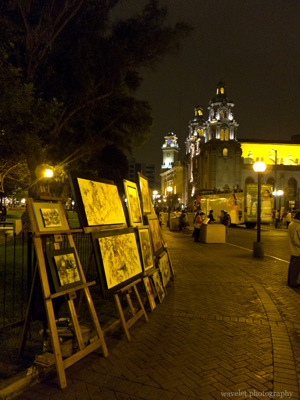 Painting stands in front of Iglesia de la Virgen Milagrosa, Parque Kennedy, Miraflores, Lima