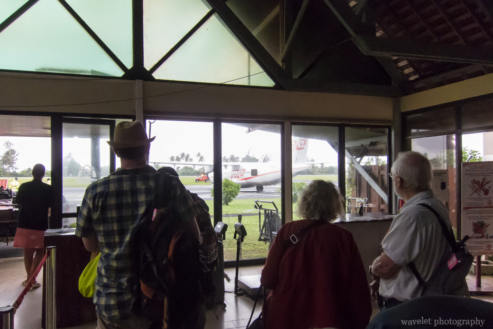 Passengers anxiously waiting for the plane at Moorea Airport