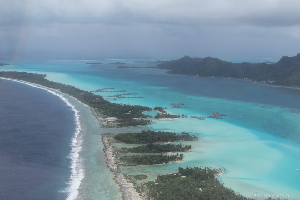 Overlook Bora Bora\'s lagoon from the airplane