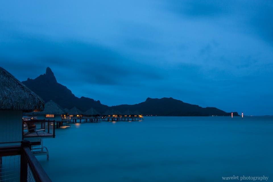 Night view of overwater bungalows of Le Méridien Bora Bora again Mount Otemanu