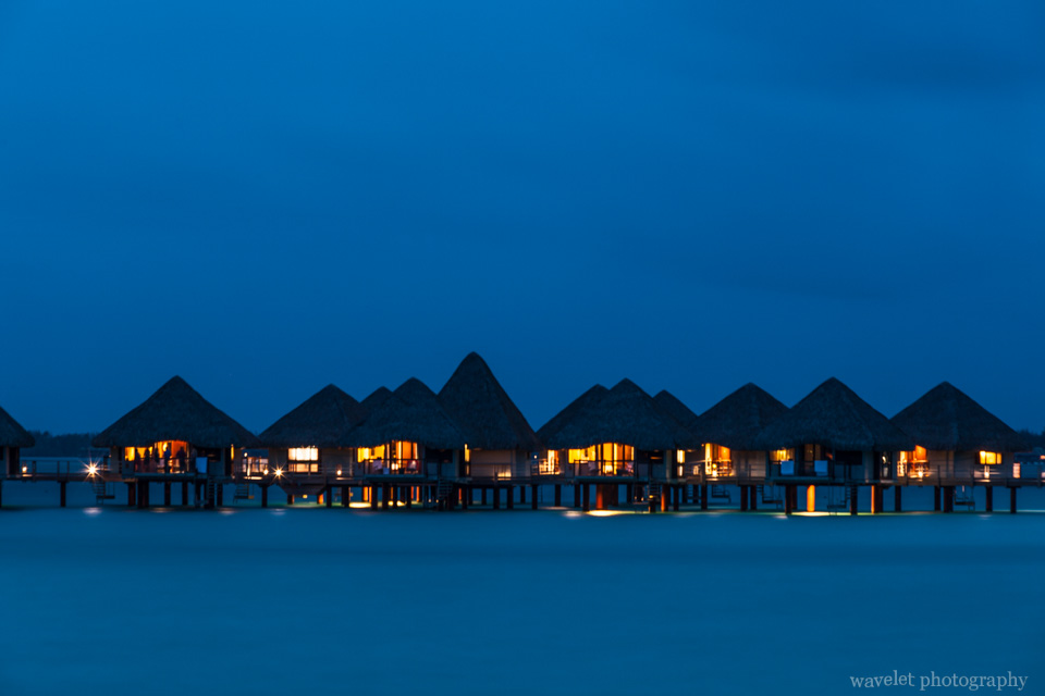 Night view of overwater bungalows of Le Méridien Bora Bora